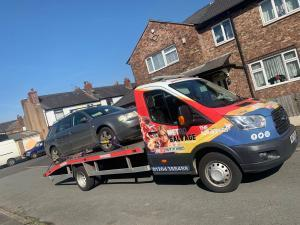 Car being taken to a local scrap yard in Bolton.