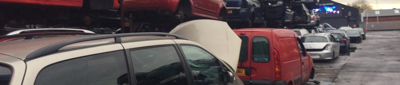 scrap cars at a Bolton breakers yard