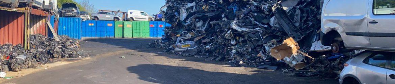 Vehicles in a Bolton car scrap yard