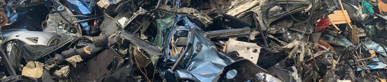 scrap metal in a car breaker's yard in Bolton