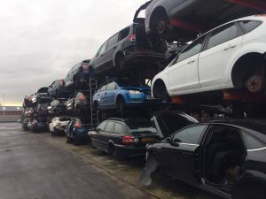 Scrapping a car in Bolton - cars stacked